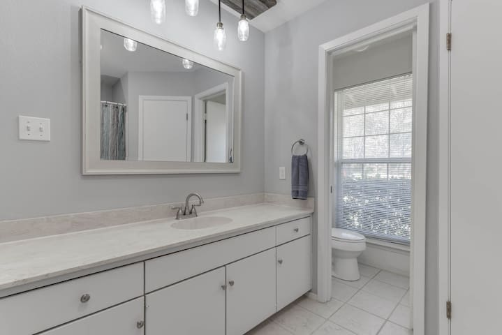 Plain but effective... Private master on-suite features soft-close barn door access, has a private toilet room, and a full size tub/shower. His and hers closets for you long term folks...