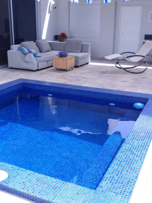 The swimming pool is 3 steps  of the room