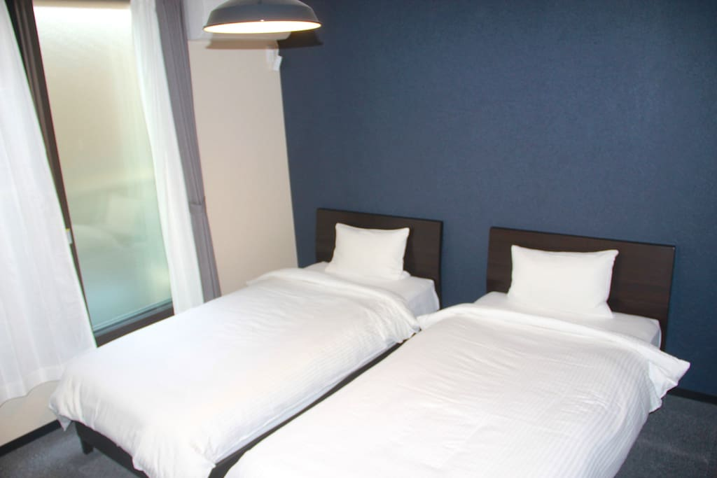 Comfortable bedroom with 2 Single beds covered by clean linen and bedding^^