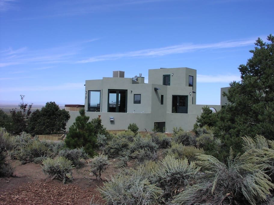 Magnificent 8-pointed Star House at foothills of Sangre de Cristos Mountains