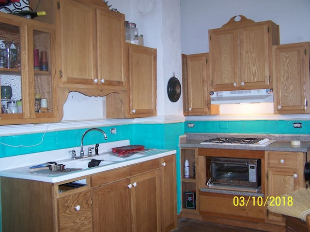 """""""New"""" kitchen sink just like Grandma's"""" - after the teal paint, but before I put back the stuff I use every day."""