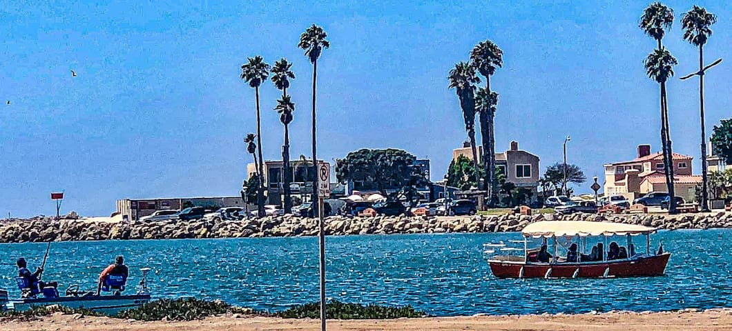 Watch the boats come into the harbor from your patio with a cool breeze and the sea lions in the background.