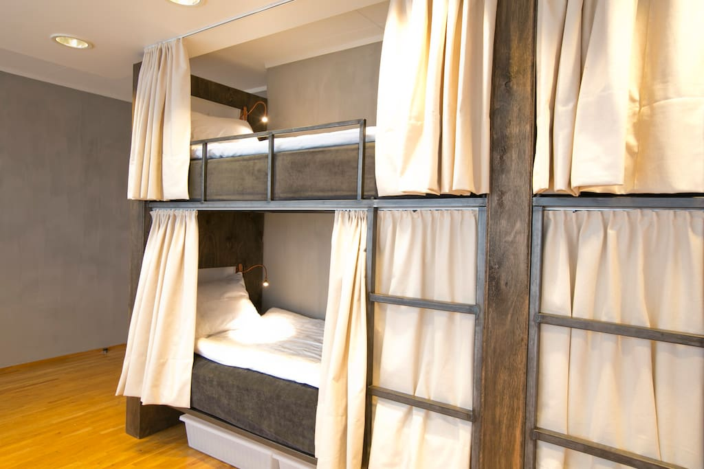 Bunk beds with drawn curtains for extra privacy