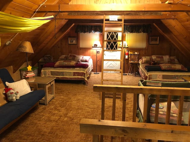 Loft, two queen beds, futon couch on left,