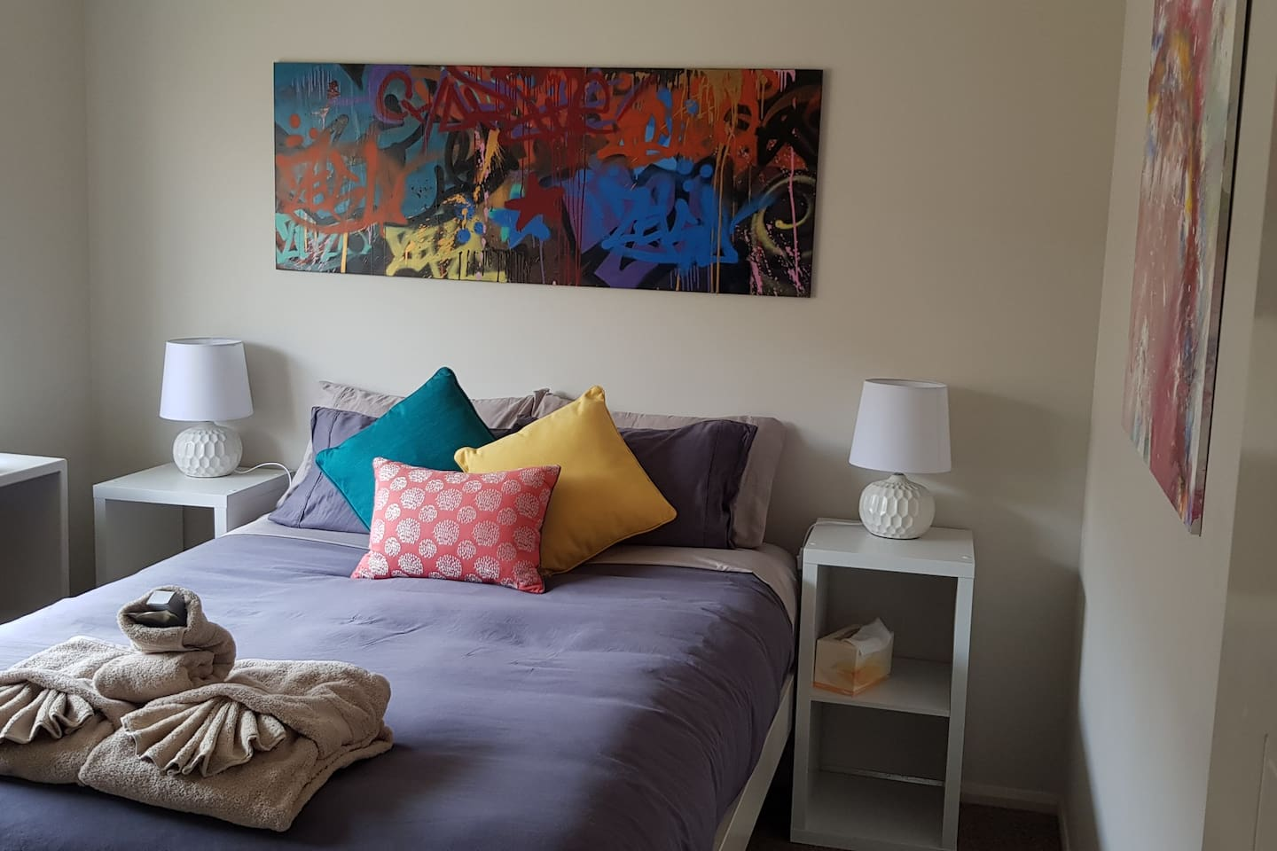 Sleep well in the very comfy bespoke bed; like a little reading to help you settle in, grab a book from the bespoke floating shelves. Appreciate the funky, then you'll like the Abstact & Graffiti art in the bedroom & Activity room.