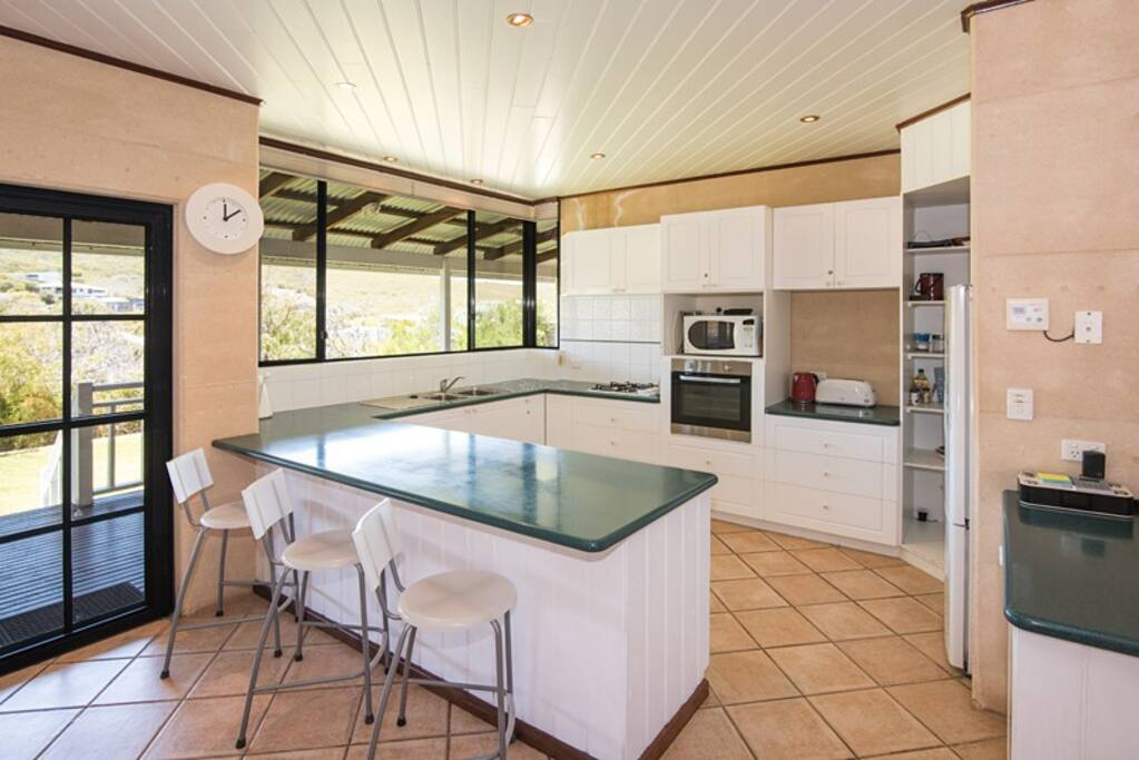 Fully equipped kitchen, the access onto the alfresco