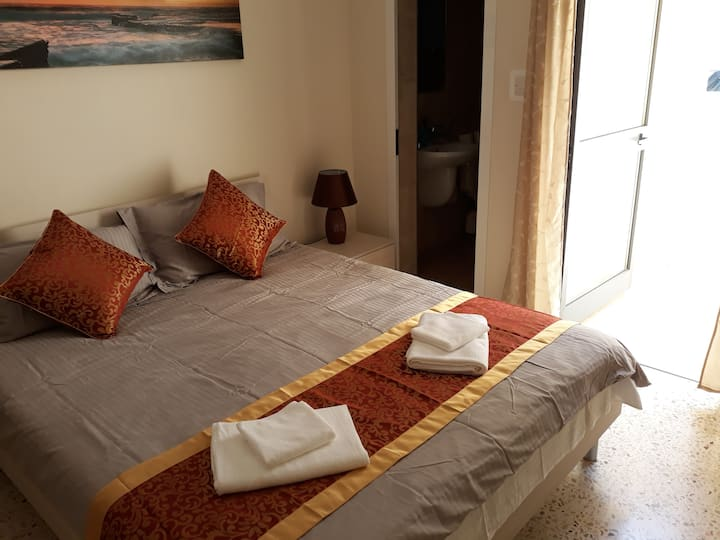 Sea Breeze Bay Guestrooms. Double room + Patio 5A