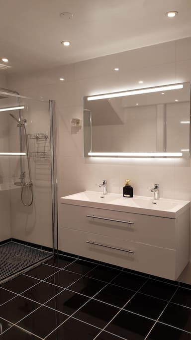 Bright bathroom with double sink.