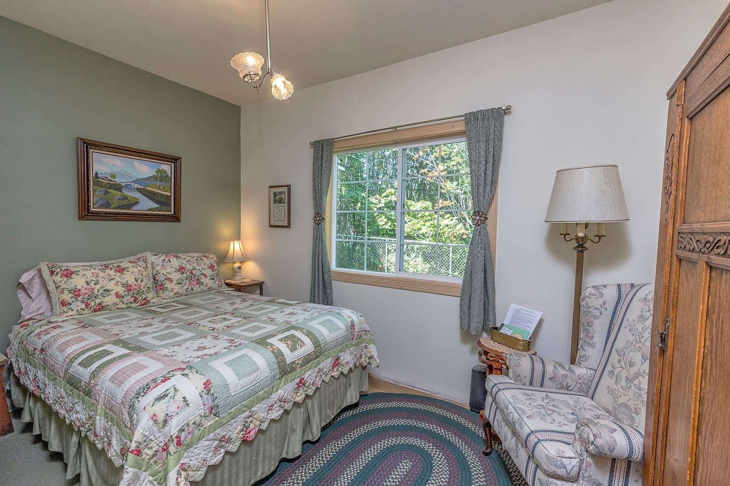 Enjoy a peaceful night's rest in the comfortable queen bed. This cozy room is located on the first floor and features the original late 1800s wood floor and a unique light fixture from the early 1900s.