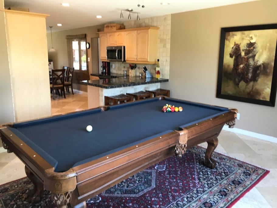 Pool table and kitchen breakfast bar
