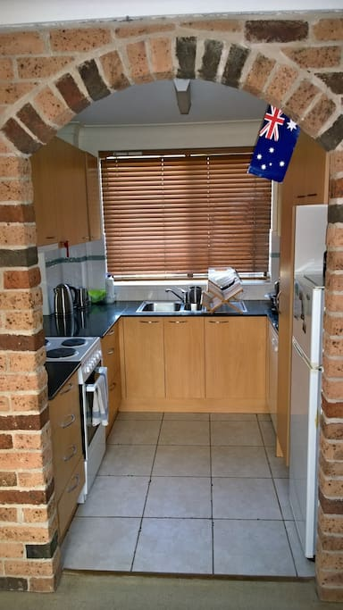 kitchen, includes fridge, microwave, dishwasher, coffe machine, toaster, stove and oven