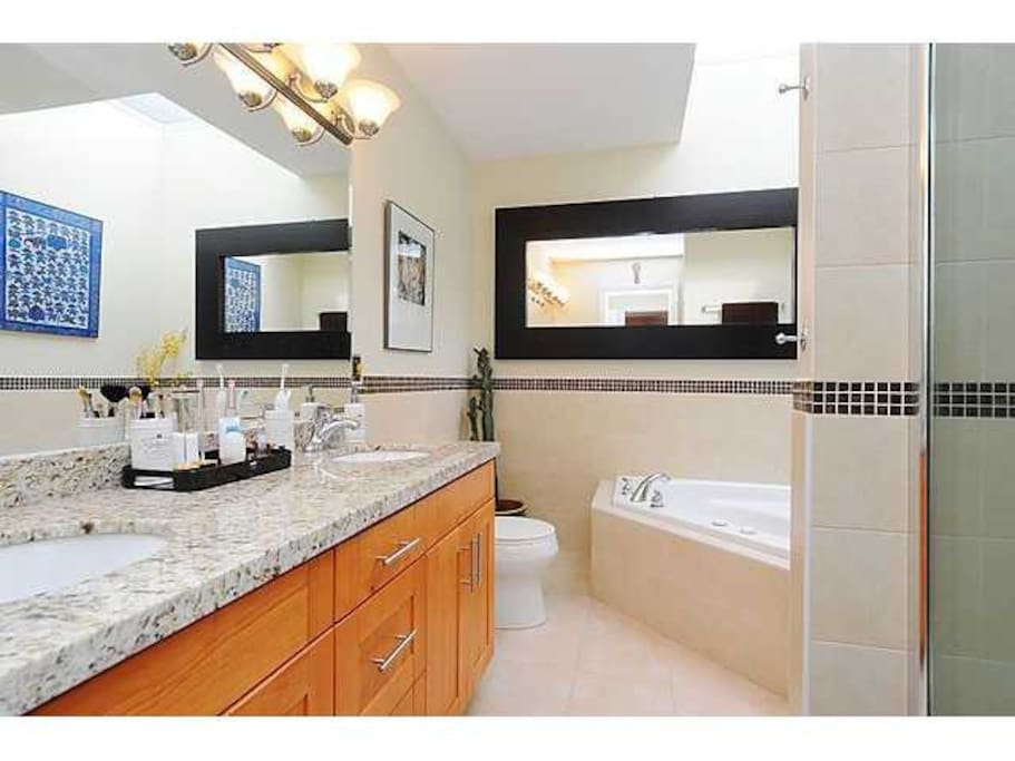 Master bathroom with bathtub (+jacuzzi function), shower, and double sink