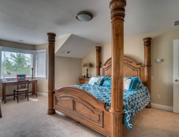 bedroom set for a king on upper level connects to jack and jill bath