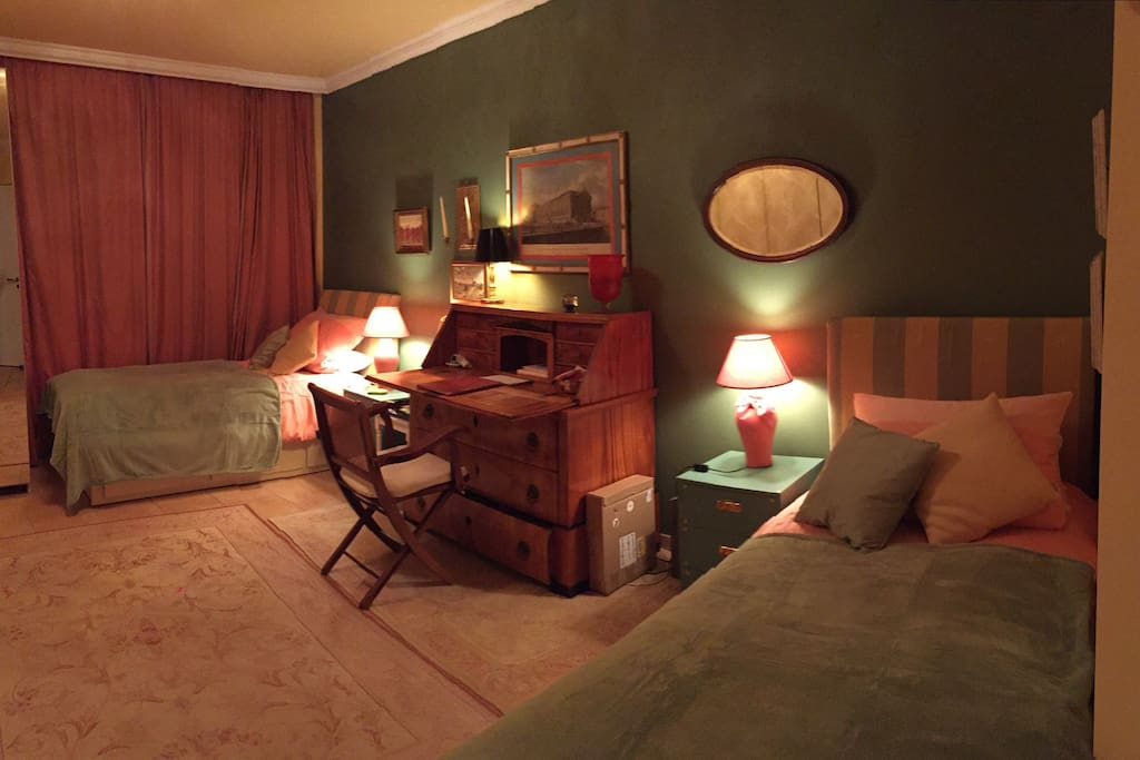guestroom with two beds at night