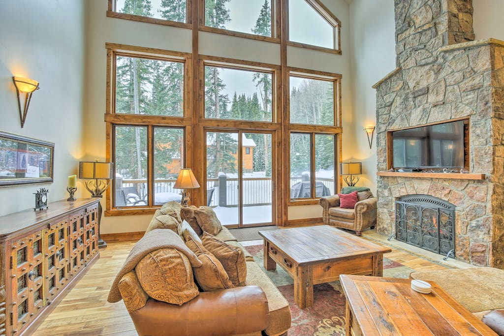 Warm up by the fireplace as natural light streams in from the windows.