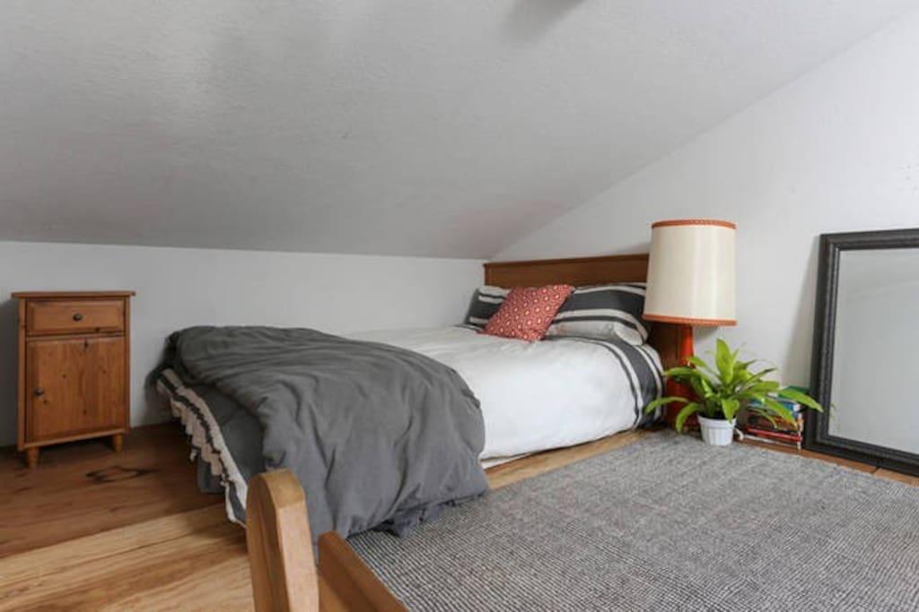Loft with soft, memory foam queen bed.