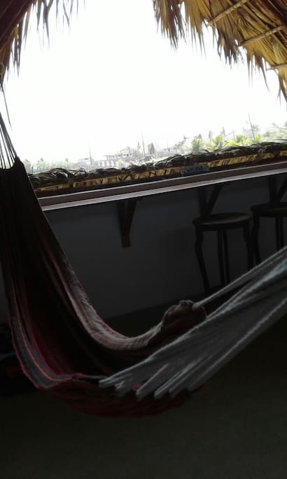 Hammock upstairs with a view to the ocean.