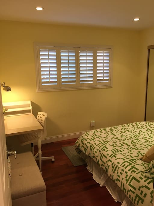 Room highlights - Queen sized bed, Side bed table with lamp, Desk table with plenty of drawers, Study lamp, Storage bench, Lutron adjustable ceiling lights switch, Wood flooring, Big windows with wooden shutters, Wall-to-wall glass sliding doors for the closet.