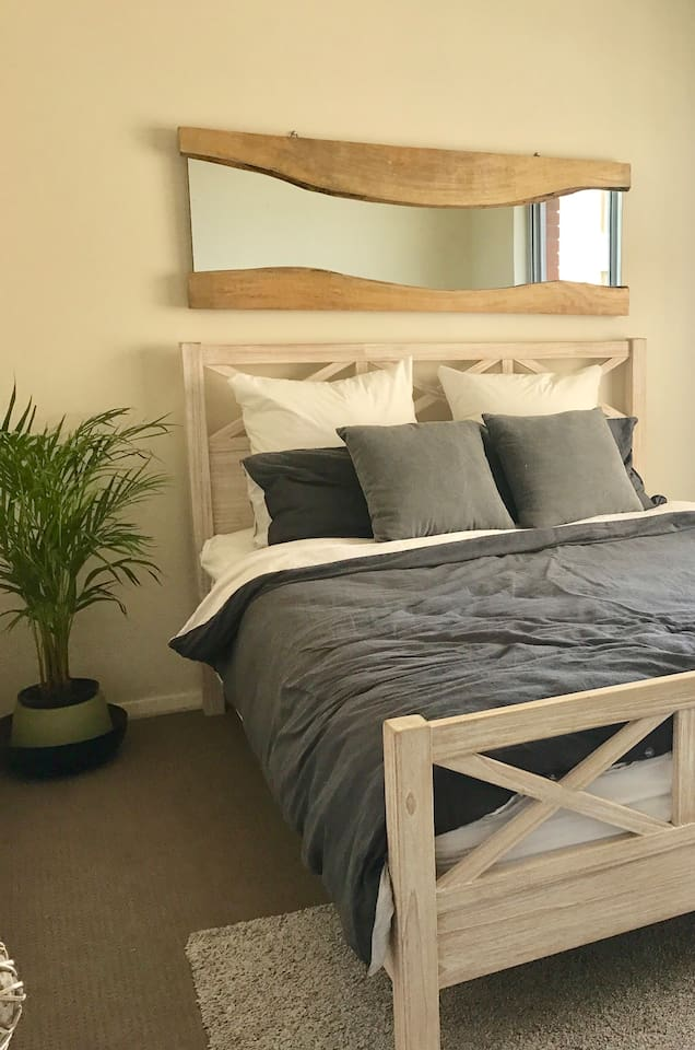 Bright airy bedroom with ocean glimpses Queen bed