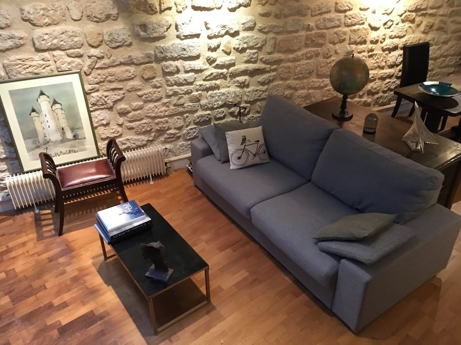 Living room with sofa that converts to double bed