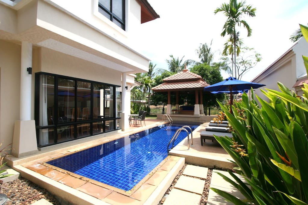 External area with sunbeds and private pool