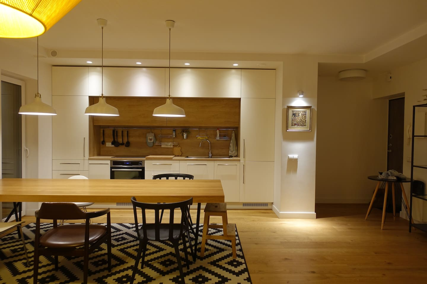 a large table and a well-stocked kitchen when you feel like eating in