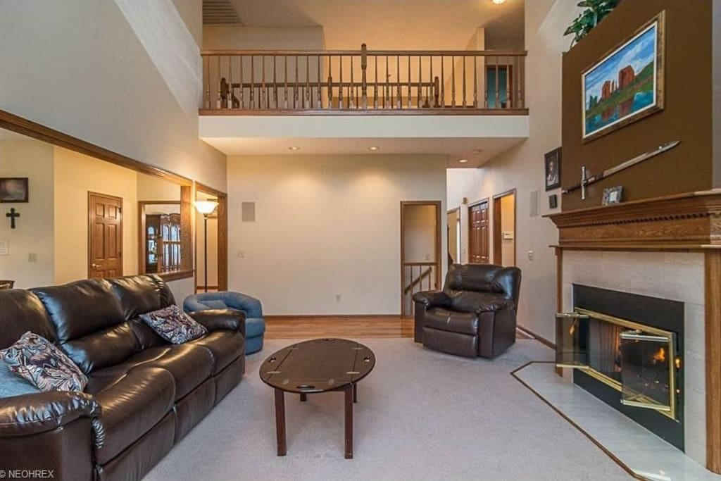 Great room with five reclining leather chairs.