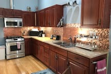 Full kitchen with propane cook stove.