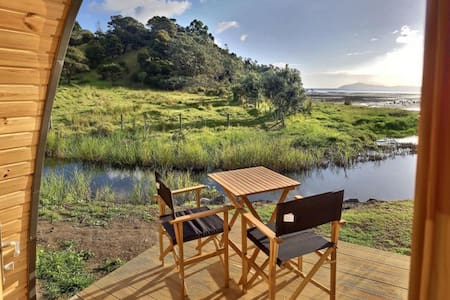 Beachside Glamping Pod overlooking the bay