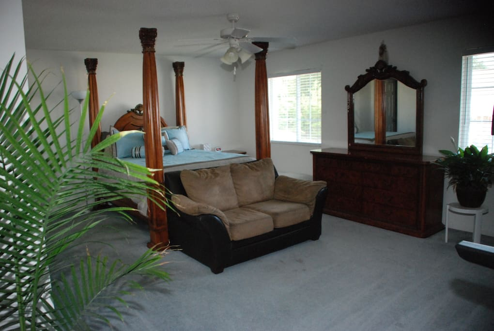Master bedroom with queen sized bed,  master bathroom with double vanity sinks & garden style tub & shower. Treadmill available for your workouts while you are traveling
