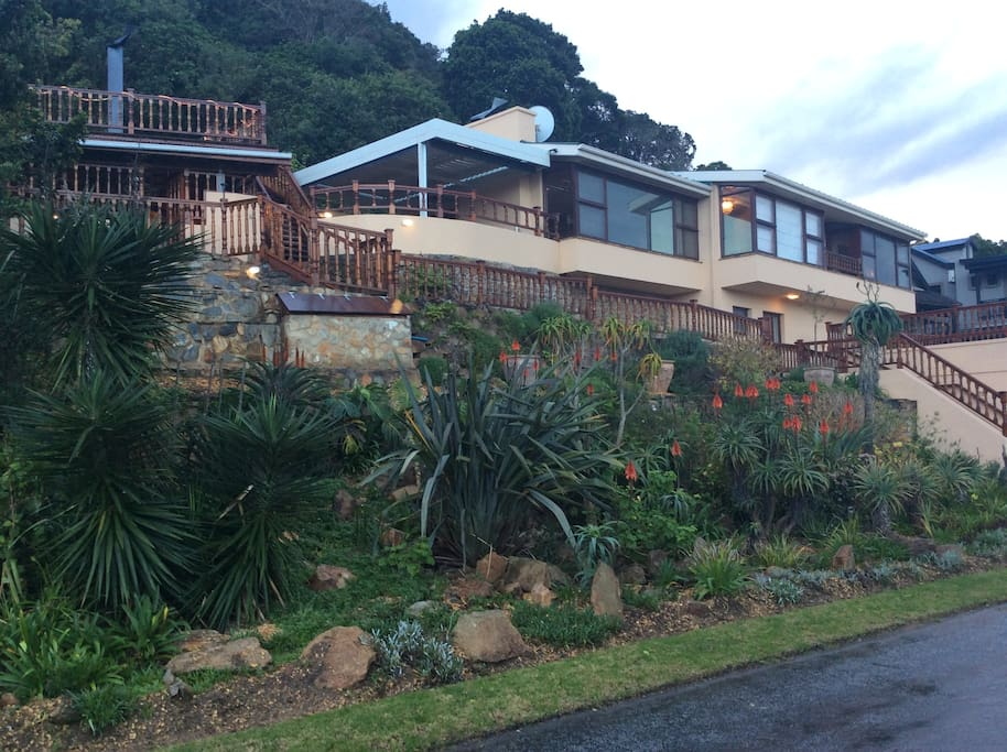 Exterior view of house and garden. Behind the house is 800 square meter private forest with footpaths