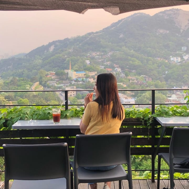 A up of coffee with beautiful view