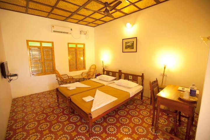 Private room in a village resort at Chettinadu