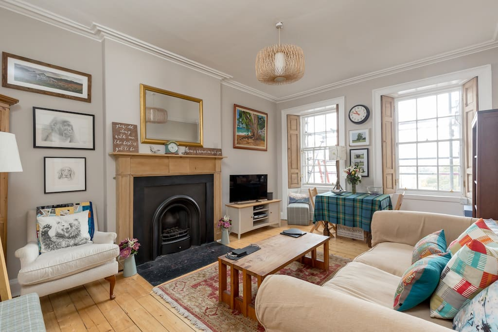 sitting room with very comfortable sofa (works as 5th person bed if needed!), Netflix TV and large DVD collection