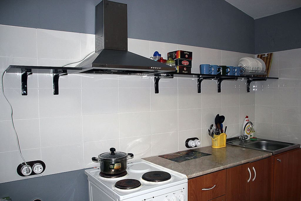 stove, sink, plates in the kitchen