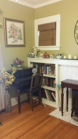 small pull out desk in room with  built-in bookshelves