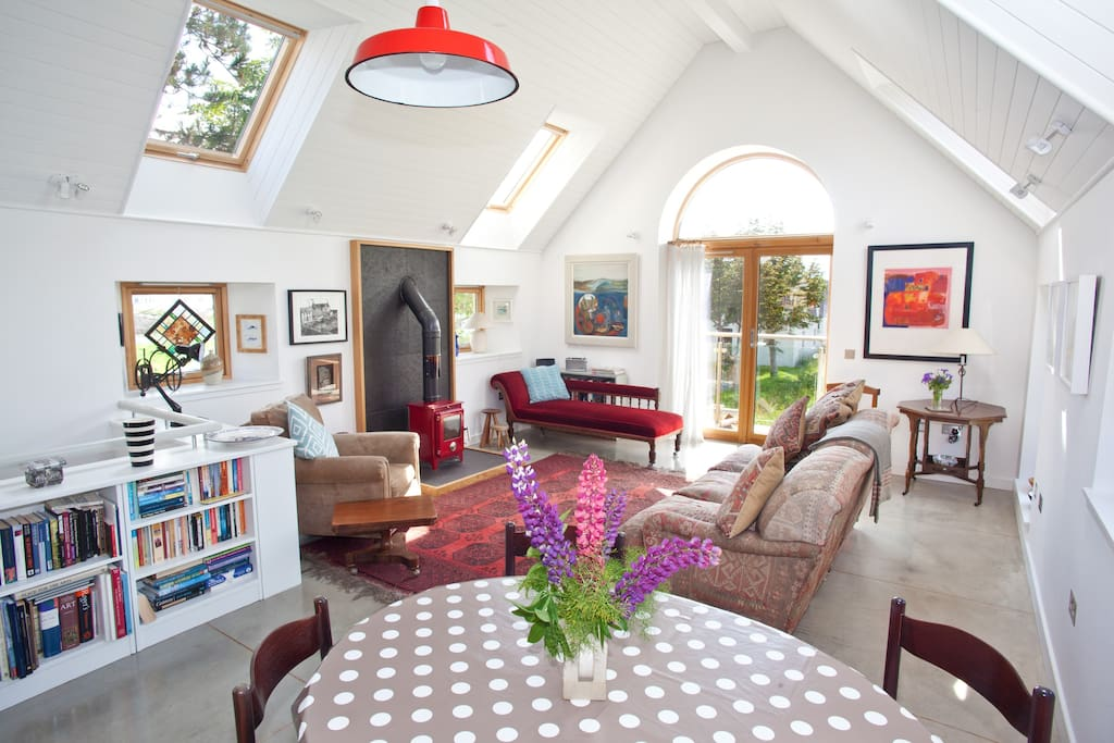 Comfy sofa, woodburner, arched window to balcony and garden