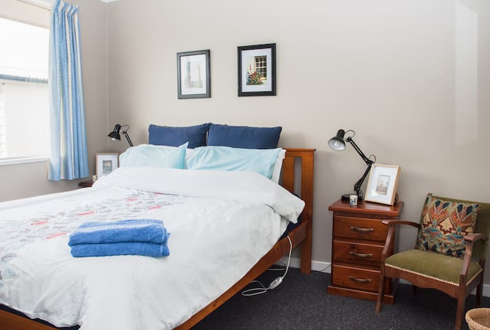 One of the double bedrooms, good quality bed and bedding, electric blanket, wardrobes, bedside lamps, sunny aspect.Oil filled radiator supplied