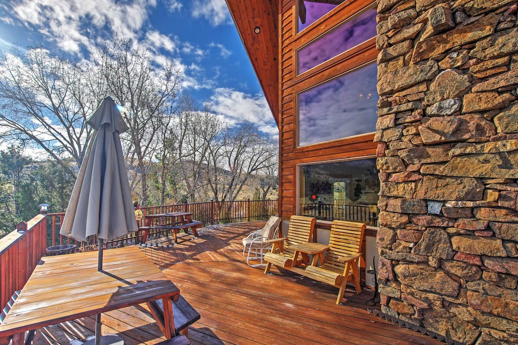 The large, wrap-around deck is the prime spot to view the breathtaking panoramic mountain views.