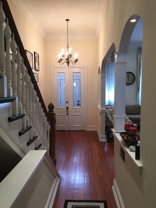 Hallway leading to living room and front door
