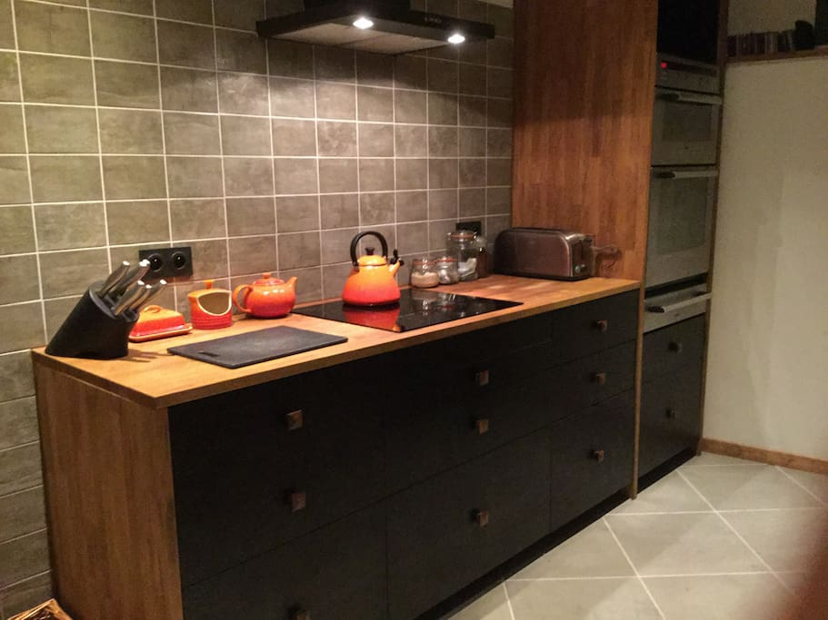 The well-equipped kitchen has an induction hob, double oven and plenty of storage space.