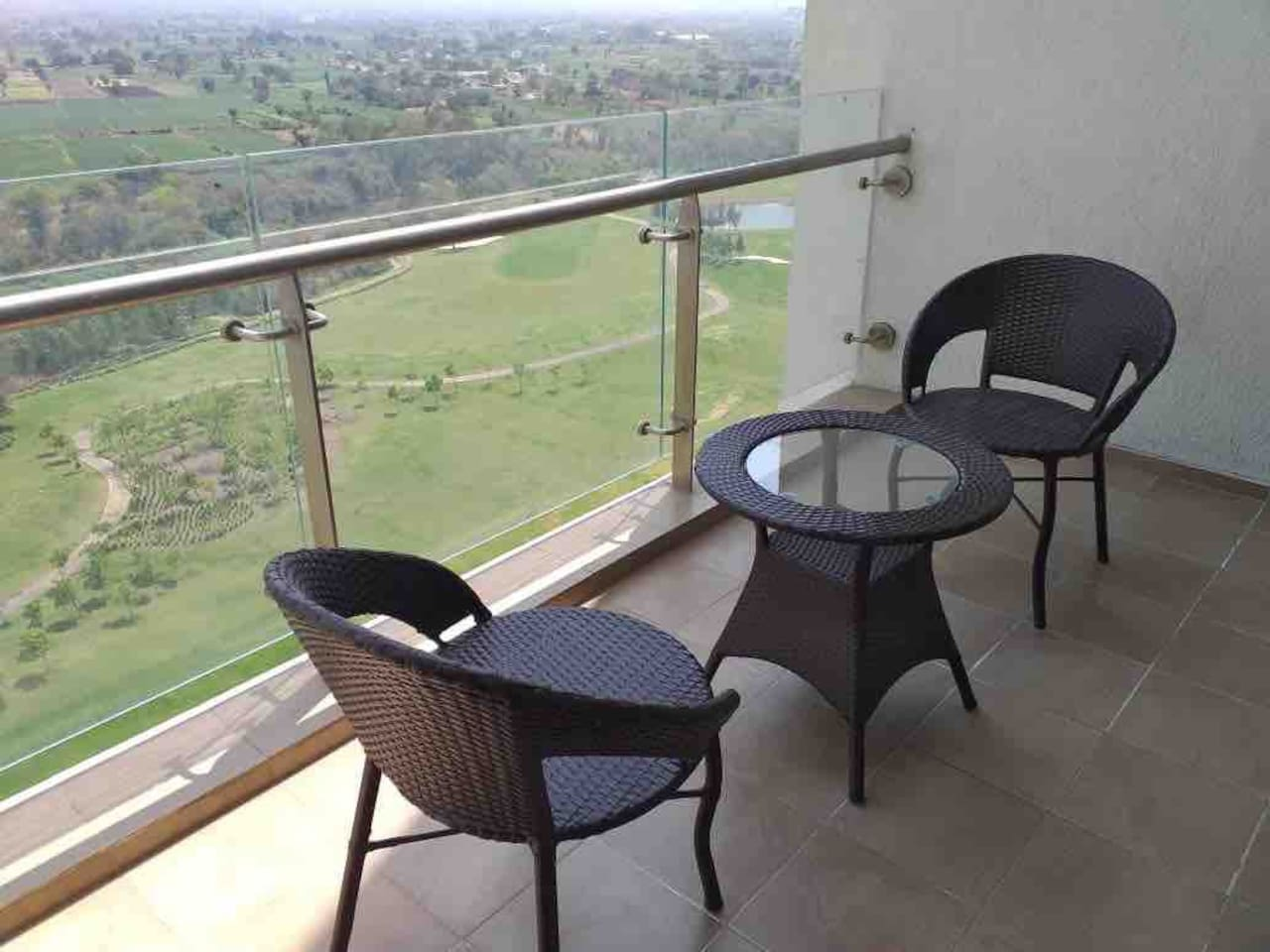 The balcony chairs invite you to soak in the cool breeze and lavish scenery spread out in front of you, over a cup of coffee or tea.