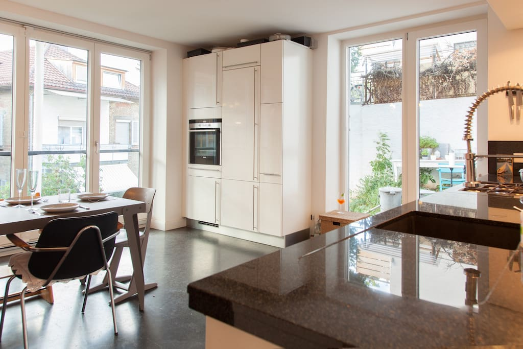 Kitchen with full front glass foldable window to garden.