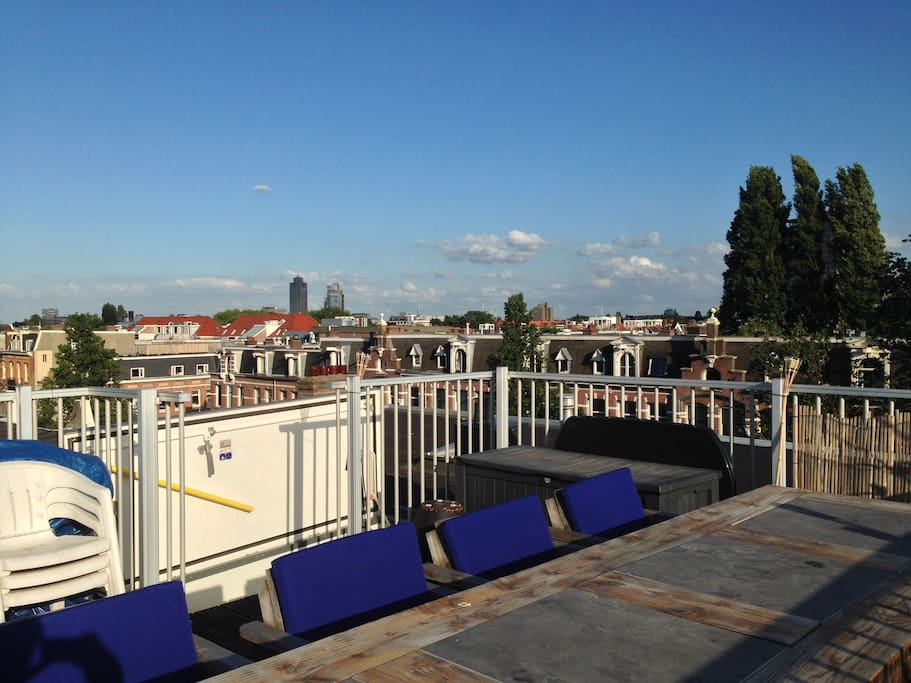 Rooftop terrace access via stairs and a hatch