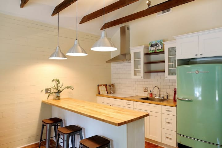 Galley style dining area, and antique fridge.