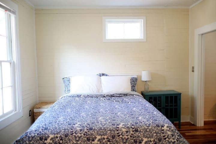 Queen sized bed in it's own bedroom.