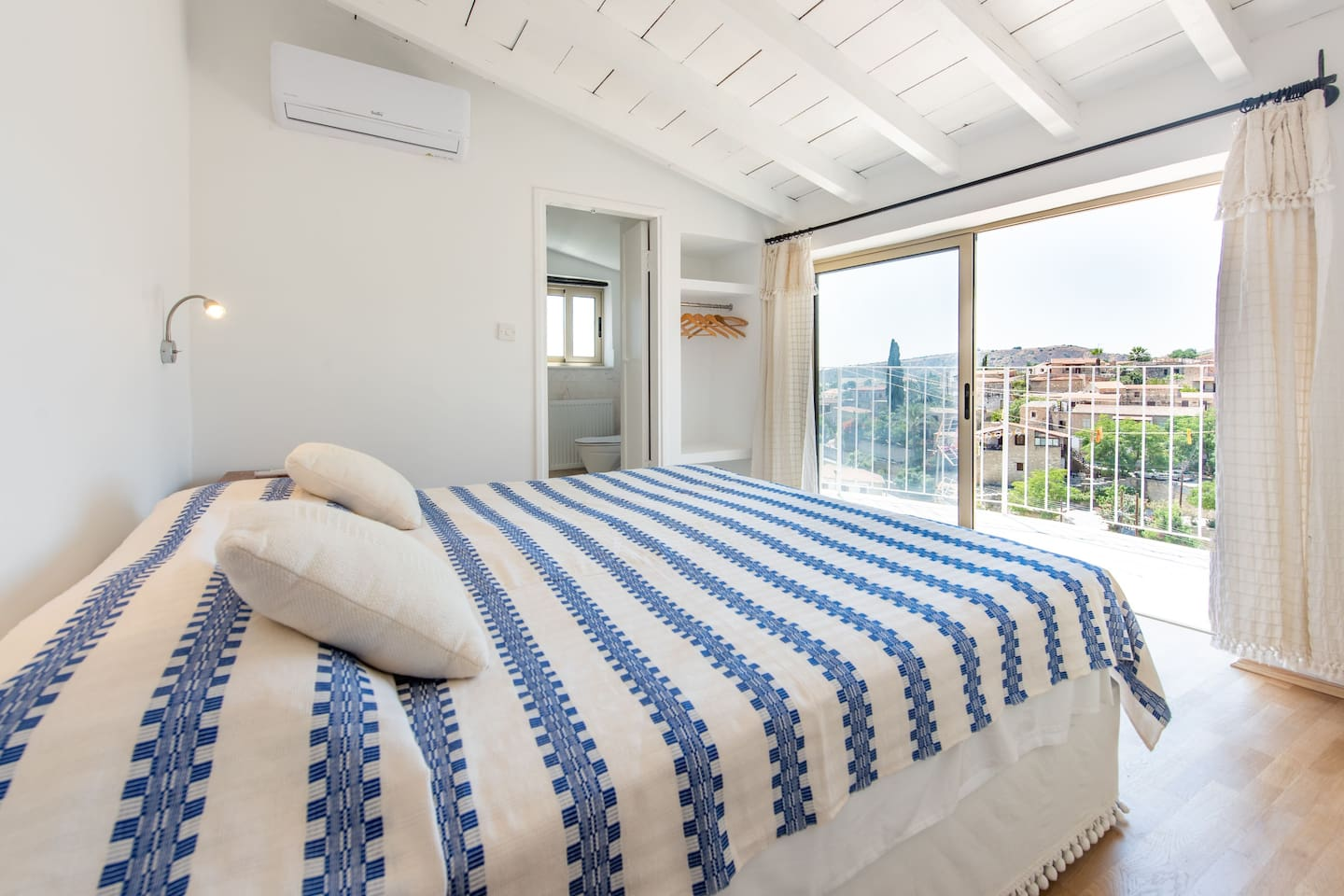Master bedroom with a panoramic view from the bed