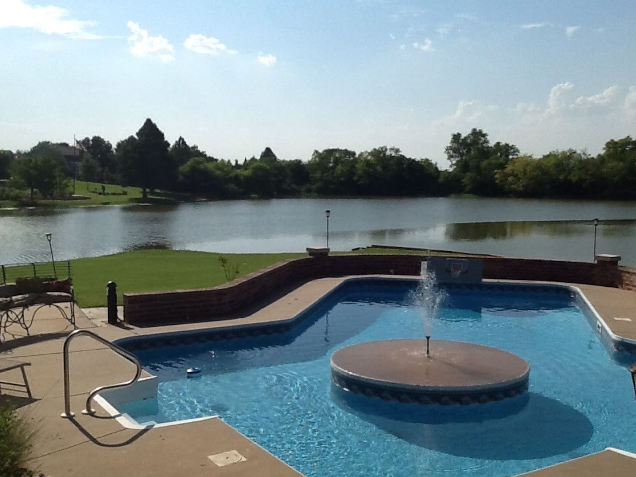View of lake and pool with fountain.