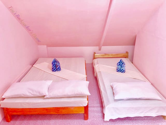 Pink Family Room good for 4-5 persons, with 1 double bed and 3 single beds