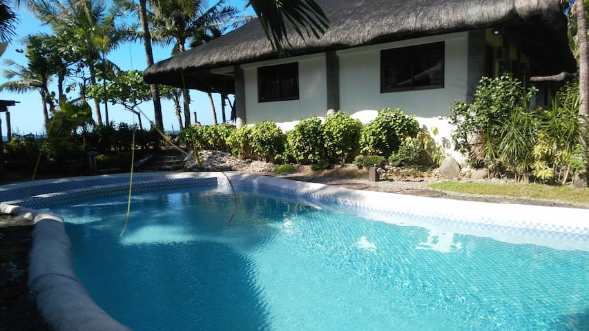 Beachfront house in Baua with swimming pool.